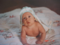 baby with blanket over head