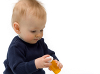 baby with pill bottle