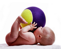 baby with a big ball on top part of toddler development