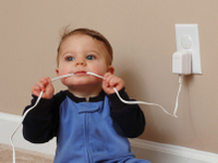 baby chewing a elec cord