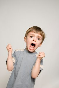 boy with fists in tantrum