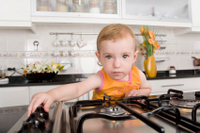 baby turing on stove