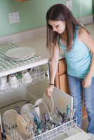 girl loading dishes