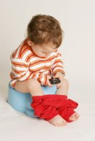 baby on potty chair and potty training problems