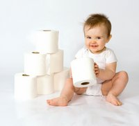 baby playing with toilet paper, potty training problems