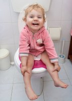 girl on potty with training seat and potty training problems