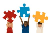 kids hold puzzle pieces