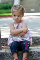 child discipline girl on timeout.