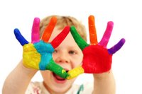 toddler with colored hands