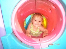 child in play tunnel